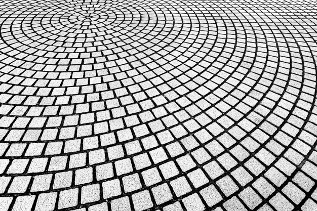Abstract background from brickwork pattern decorated on floor in curve shape.